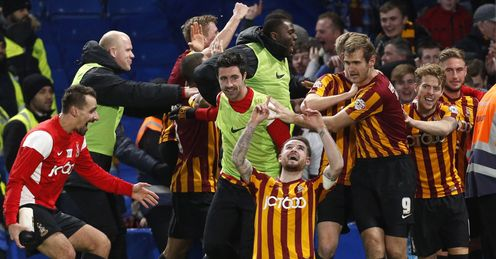 Mark Yeates celebrates after scoring Bradford's fourth goal against Chelsea