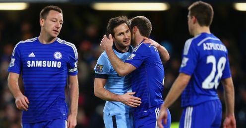 Frank Lampard of Manchester City embraces Branislav Ivanovic of Chelsea