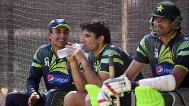 Pakistan captain Misbah-ul-Haq (C) shares a lighter moment with teammates Nasir Jamshed (L) and Mohammad Irfan (R)