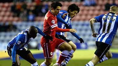 Cardiff's Peter Whittingham takes  on the Wigan defence