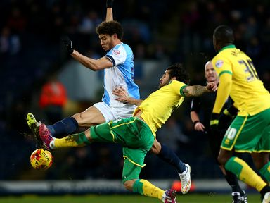 Rudy Gestede of Blackburn is challenged by Bradley Johnson