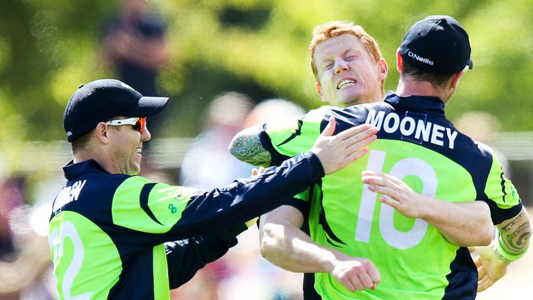 Kevin O'Brien of Ireland celebrates with teammates John Mooney and Niall O'Brien after taking the wicket of Dwayne Smith