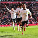 Juan Mata: Celebrates scoring his second goal for United at Liverpool