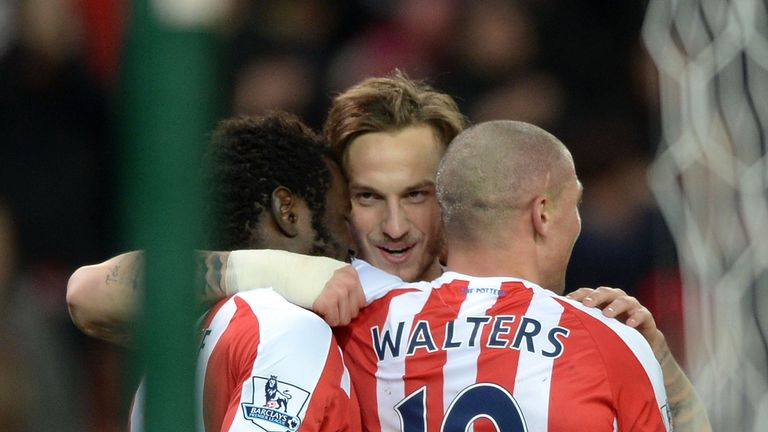 Diouf celebrates Stoke's second with team-mates