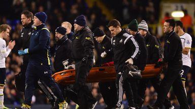 Bafetimbi Gomis of Swansea City is stretchered off at White Hart Lane