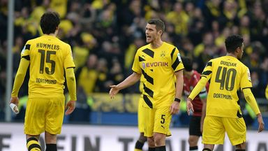 Dortmund players celebrate during their 3-2 win at Hannover
