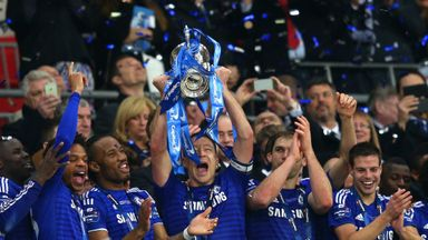John Terry of Chelsea lifts the Capital One Cup trophy