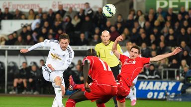 Gylfi Sigurdsson scores for Swansea against Liverpool in the Premier League last season
