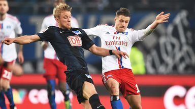 Per Ciljan Skjelbred (left) of Hertha Berlin in action against Hamburg