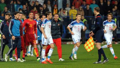 Players leave the pitch Montenegro v Russia