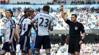 Gareth McAuley is shown the red card by Neil Swarbrick against Manchester City