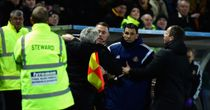 Steve Bruce is held back by the assistant referee as he and Gus Poyet argue