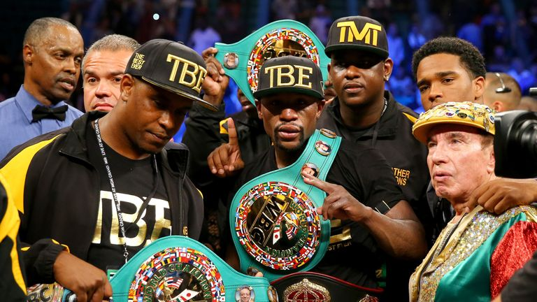 Floyd Mayweather Jr. shows off his world title belts following last year's win over Marcos Maidana