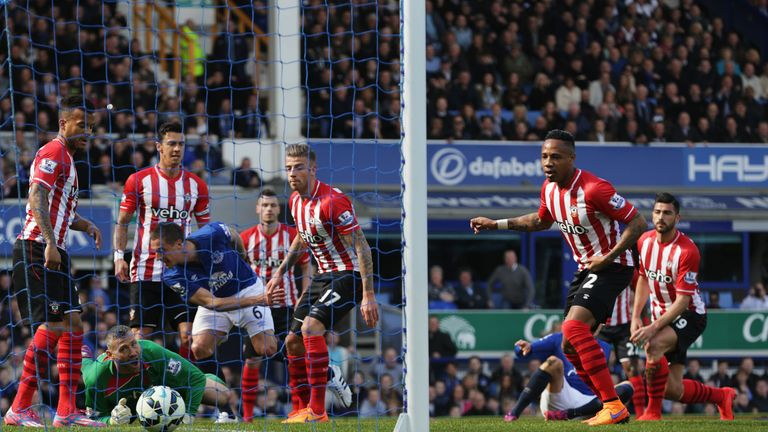 Phil Jagielka slots home Everton's opening goal on 16 minutes