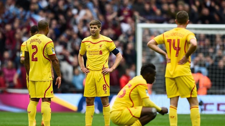 The Liverpool players look deflated after their FA Cup semi-final defeat