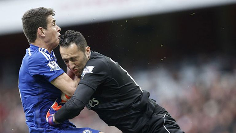 Chelsea's Oscar collides with Arsenal keeper David Ospina at the Emirates on Sunday