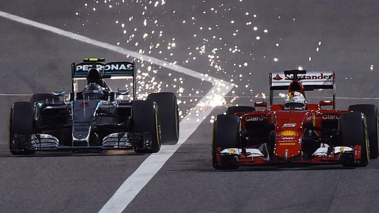 Sparks fly as Nico Rosberg overtakes Sebastian Vettel during the Bahrain GP.