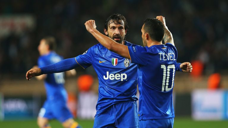 Andrea Pirlo and Carlos Tevez celebrate at the final whistle