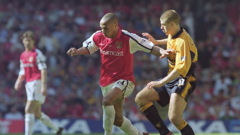 Thierry Henry and Steven Gerrard in action for Arsenal and Liverpool respectively