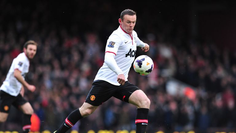 Wayne Rooney shoots to score the opening goal during the game against West Ham