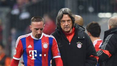 An injured Franck Ribery of Bayern Munich walks with club doctor Hans-Wilhelm Mueller-Wohlfahrt