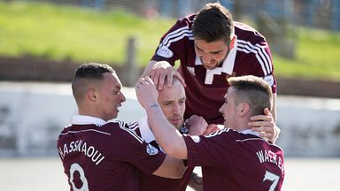 Hearts' Brad McKay (centre) is surrounded by his team-mates as he grabs a late winner for his side
