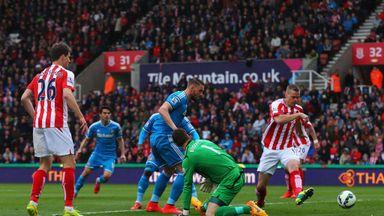 Connor Wickham of Sunderland scores the opening goal past Asmir Begovic of Stoke City