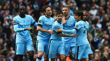 Manchester City players celebrate in a convincing win