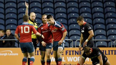 Conor Murray is congratulated after scoring Munster's third try at Murrayfield