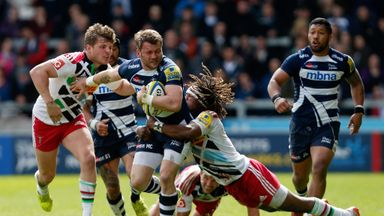 Sale wing Mark Cueto is tackled by Quins duo Harry Sloan and Marland Yarde