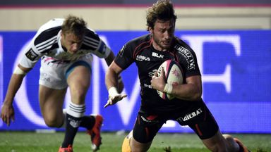 Toulouse full-back Maxime Medard scores a try in front of France team-mate Jules Plisson