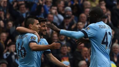 Sergio Aguero, Jesus Navas and Yaya Toure celebrate