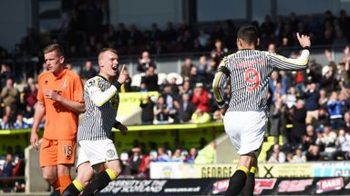 St Mirren's Steven Thompson  wheels away to celebrate scoring his second penalty of the game