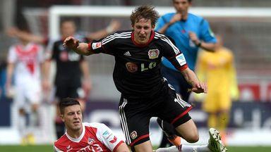 Stefan Kiessling of Leverkusen is brought down by Kevin Wimmer
