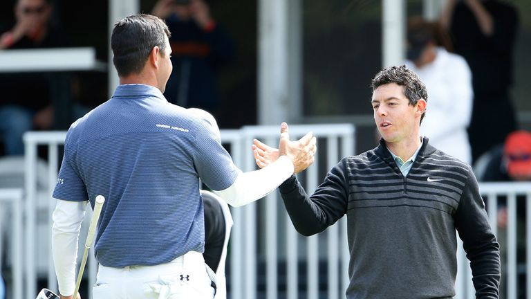 McIlroy shakes hands with Gary Woodland after winning the 2015 WGC-Cadillac Match Play