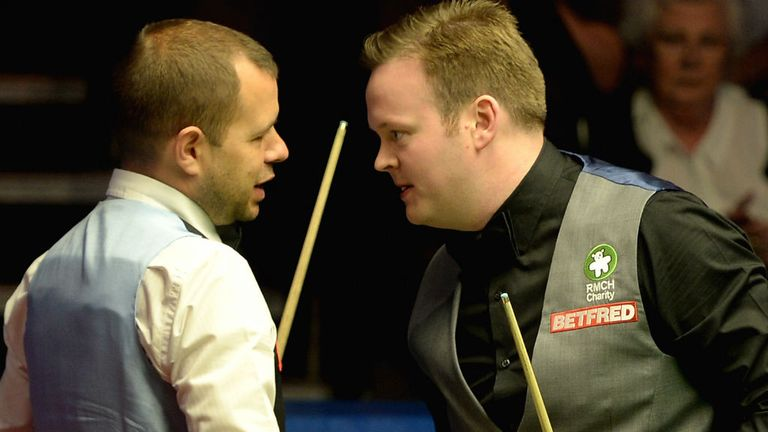 Shaun Murphy shakes hands with Barry Hawkins after defeating him 17-9