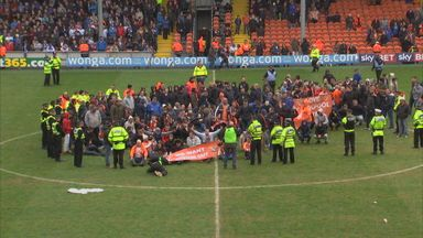 Blackpool fans hold sit-down protest during the match with Huddersfield