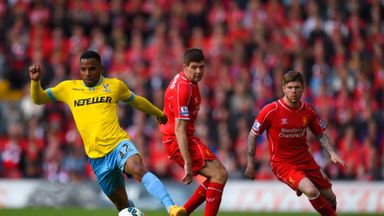 Jason Puncheon of Crystal Palace breaks away from Steven Gerrard and Alberto Moreno of Liverpool