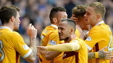Motherwell's Lionel Ainsworth celebrates his goal with his team-mates.