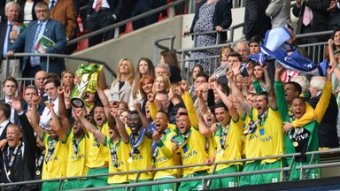 Russell Martin lifts the trophy after winning the play-off final at Wembley