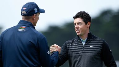 Rory McIlroy of Northern Ireland shakes hands with Jim Furyk after winning their semi final match to advance to the final in the WGC.