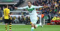 Bas Dost: Celebrates scoring Wolfsburg's third goal.
