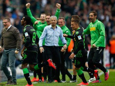 Borussia Monchengladbach players celebrate after their late winner against Hertha Berlin