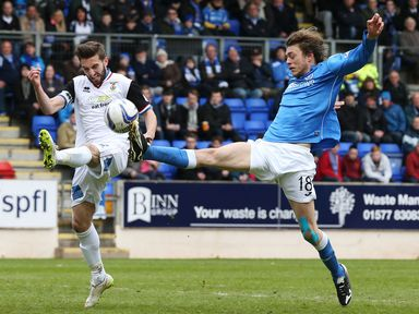Inverness's  Graeme Shinnie (left) battles for the ball against Murray Davidson of St Johnstone
