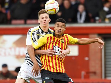 Partick Thistle's Lyle Taylor holds off Thomas Reilly