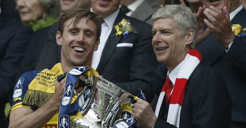 Arsene Wenger: Lifts the FA Cup with Nacho Monreal