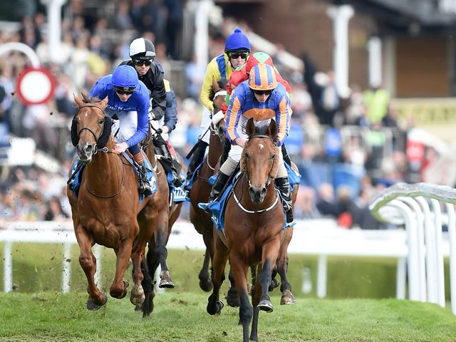 Hans Holbein (right), ridden by Ryan Moore, on his way to winning the MBNA Chester Vase at the Boodles May Festival