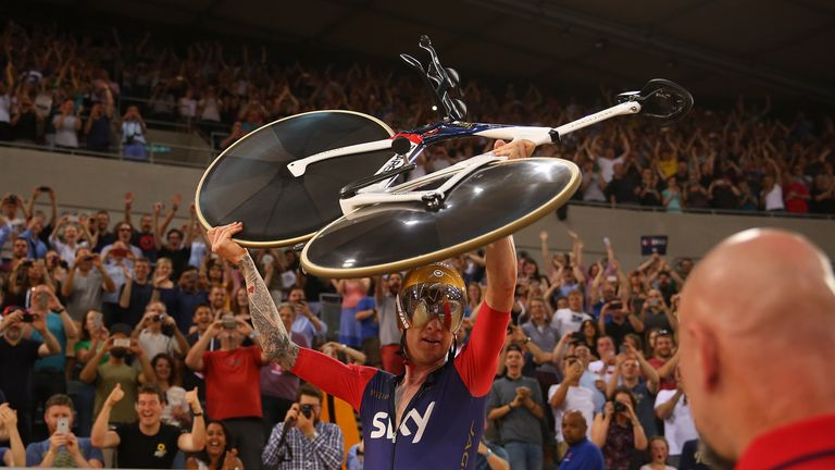 Sir Bradley Wiggins celebrates breaking the UCI Hour Record