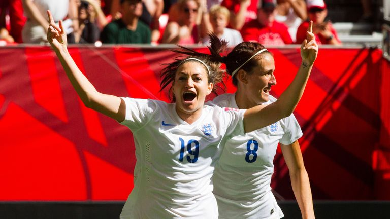 England's Jodie Taylor celebrates her opening goal against Canada with Jill Scott.