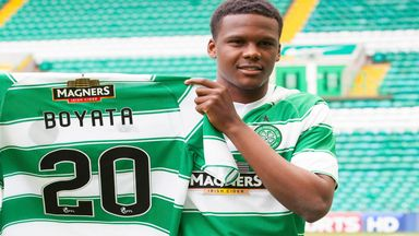 Dedryck Boyata shows off his new Celtic jersey after completing a four-year deal from Manchester City.